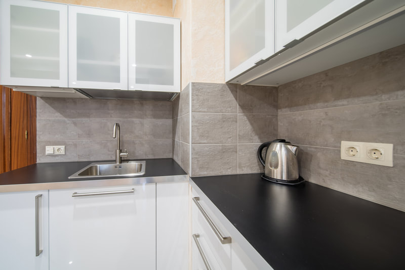 clean kitchen with kettle